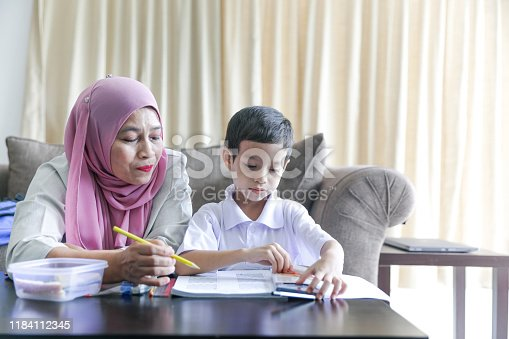 1151176639 istock photo Mom and kids preparing to go to school 1184112345