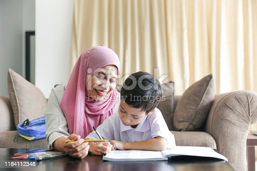 1151176639 istock photo Mom and kids preparing to go to school 1184112348