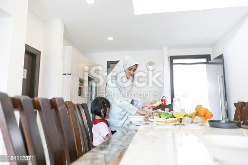 1151176639 istock photo Mom and kids preparing to go to school 1184112371