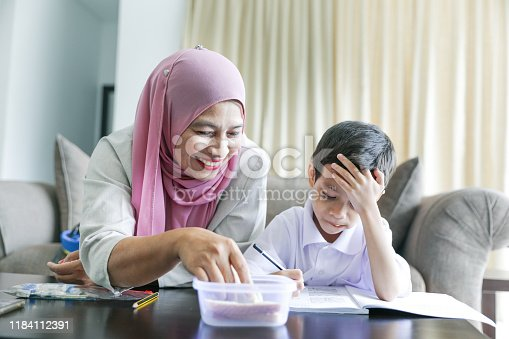 1151176639 istock photo Mom and kids preparing to go to school 1184112391