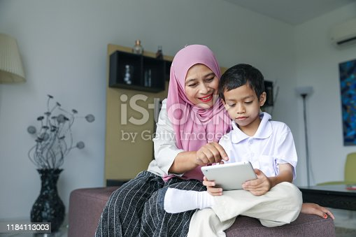 1151176639 istock photo Mom and kids preparing to go to school 1184113003