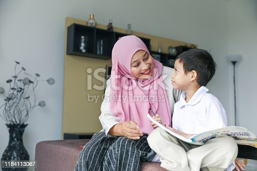 1151176639 istock photo Mom and kids preparing to go to school 1184113067