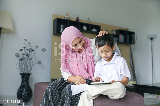 1151176639 istock photo Mom and kids preparing to go to school 1184113131