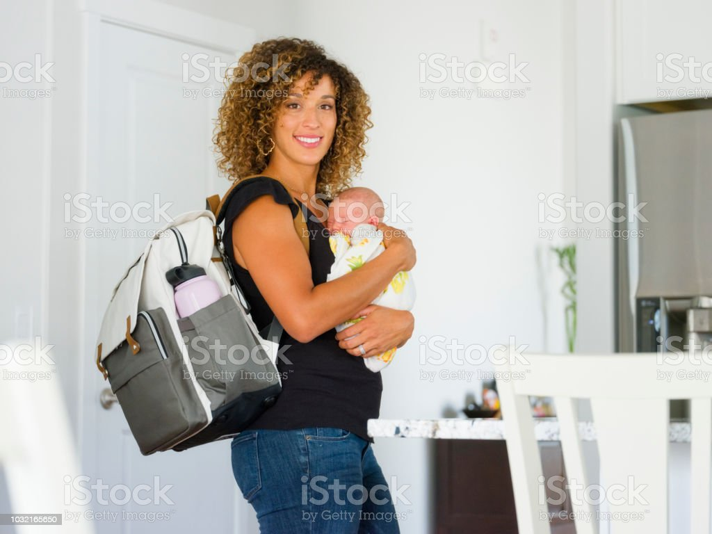 Mom and Newborn Baby in a Home stock photo