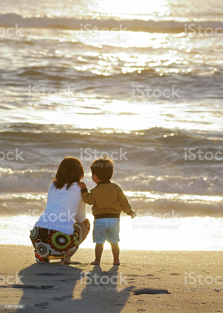 mom and son at sunset royalty-free stock photo