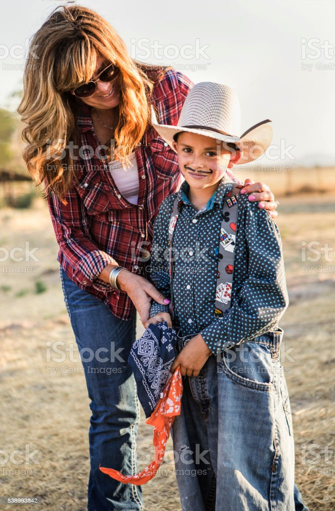 Mom and son at the rodeo stock photo