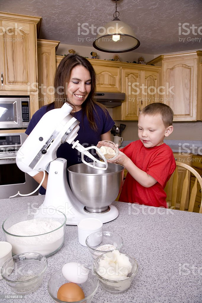 Mom and son baking royalty-free stock photo