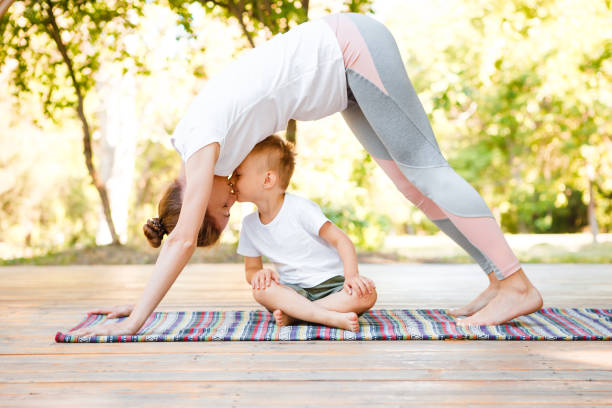 Mom and son do yoga in a summer park healthy lifestyle picture id1200932578?b=1&k=6&m=1200932578&s=612x612&w=0&h=bt3muluj0vdoce4bgpo 26eipdapn8xtwlrrhyf70jk=
