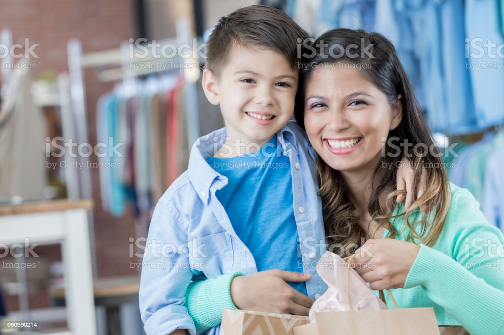 Mom and son enjoy shopping together stock photo