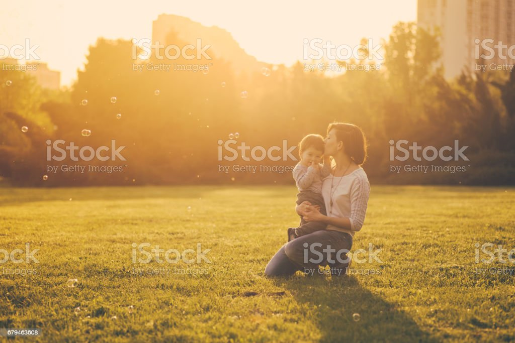 Mom and son have fun and make balloons from soap royalty-free stock photo
