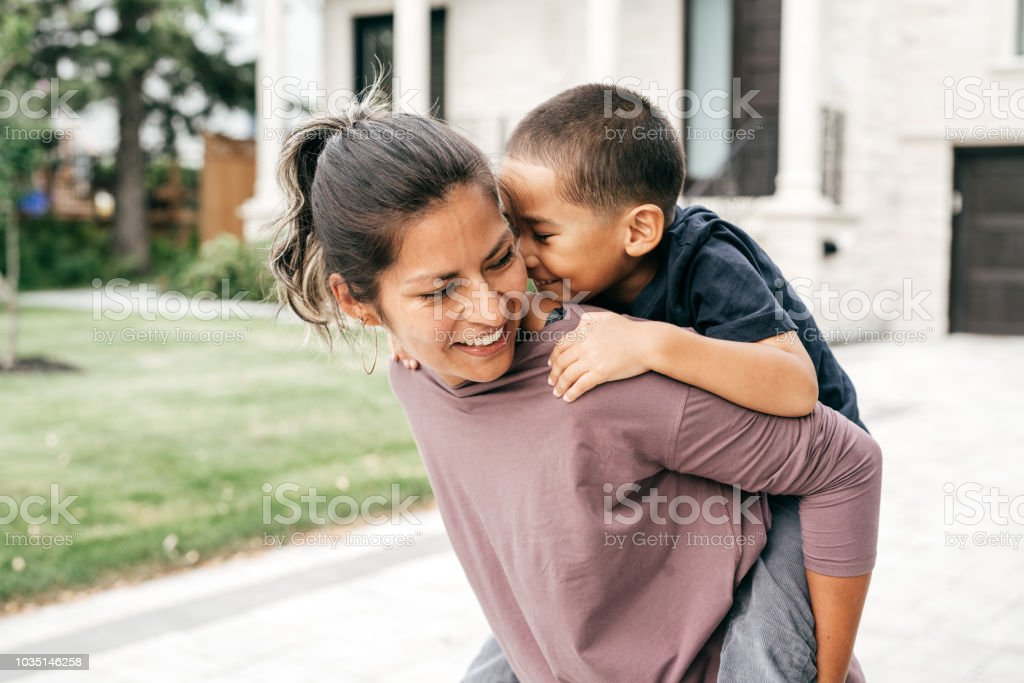Mom and son having fun outdoor - Royalty-free Child Stock Photo