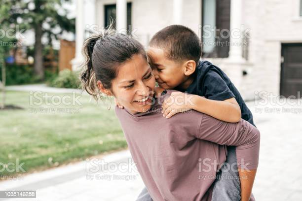 Mom And Son Having Fun Outdoor Stock Photo - Download Image Now