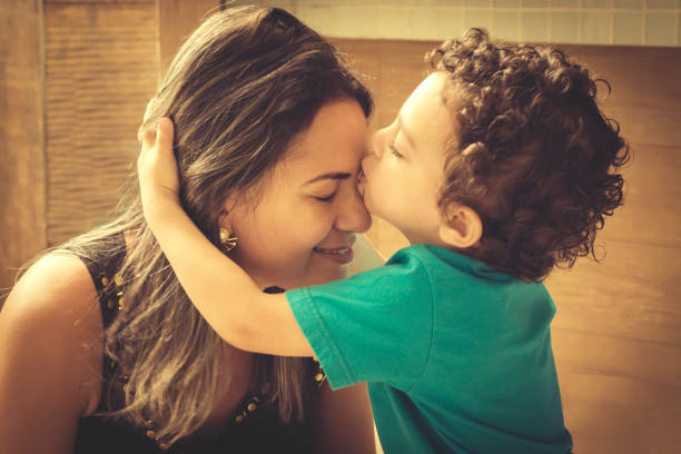 mom and son - affectionate stock pictures, royalty-free photos & images
