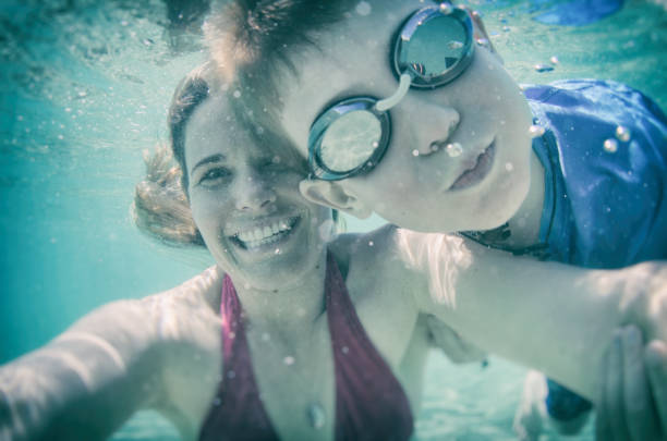 Mom and son with a goofy underwater selfie stock photo
