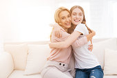 istock Mom and teenage daughter embrace. 897429254