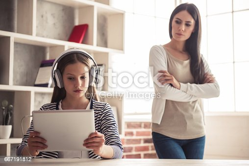istock Mom and troubled daughter 667191812