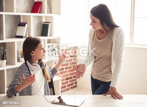 istock Mom and troubled daughter 667191924