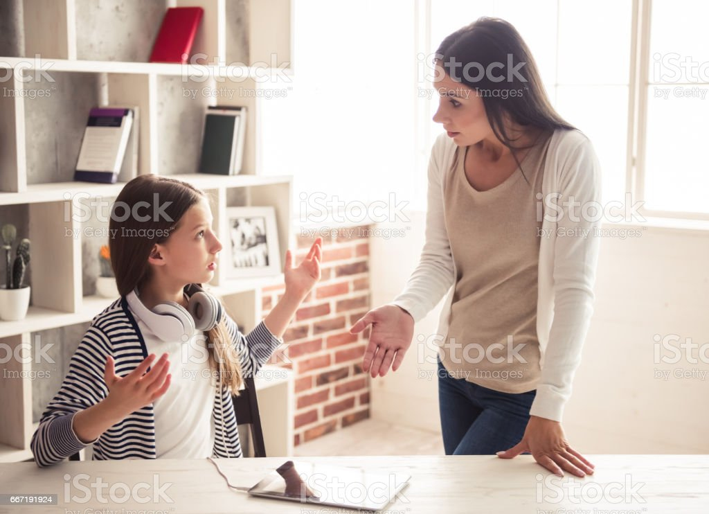 Mom and troubled daughter stock photo
