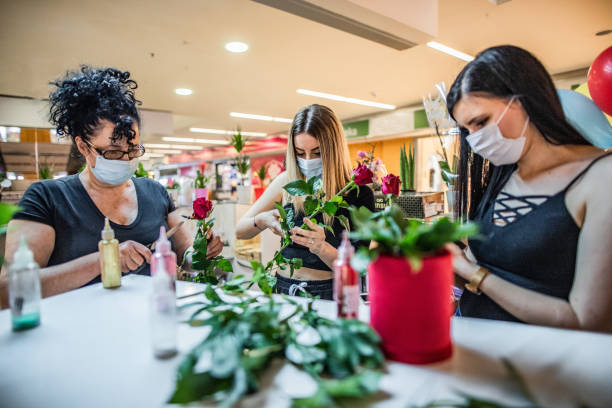 Mom and two daughters work in  florist