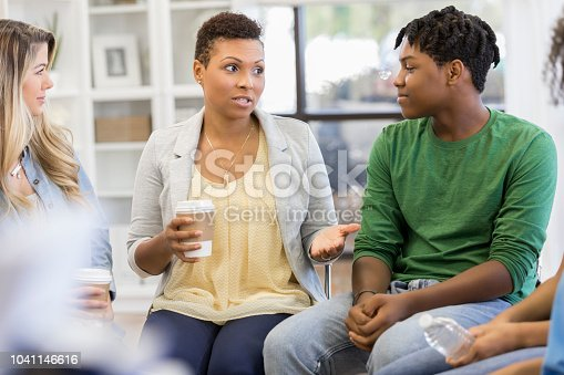 1055095320 istock photo Mom attends support group with son 1041146616