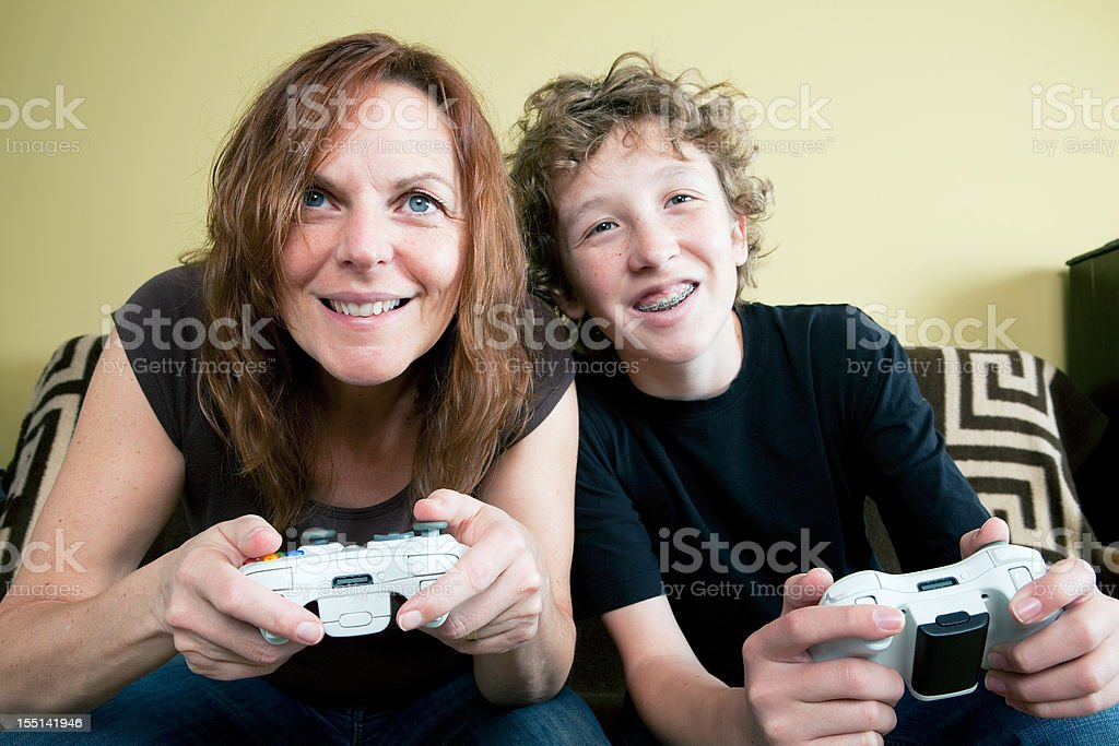 Mom Challenges Her Son To A Video Game Stock Photo