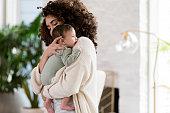 istock Mom comforts fussy baby 1209161477
