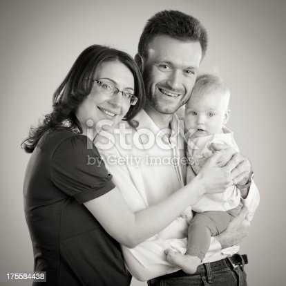 525959168 istock photo Mom dad and baby girl 175584438