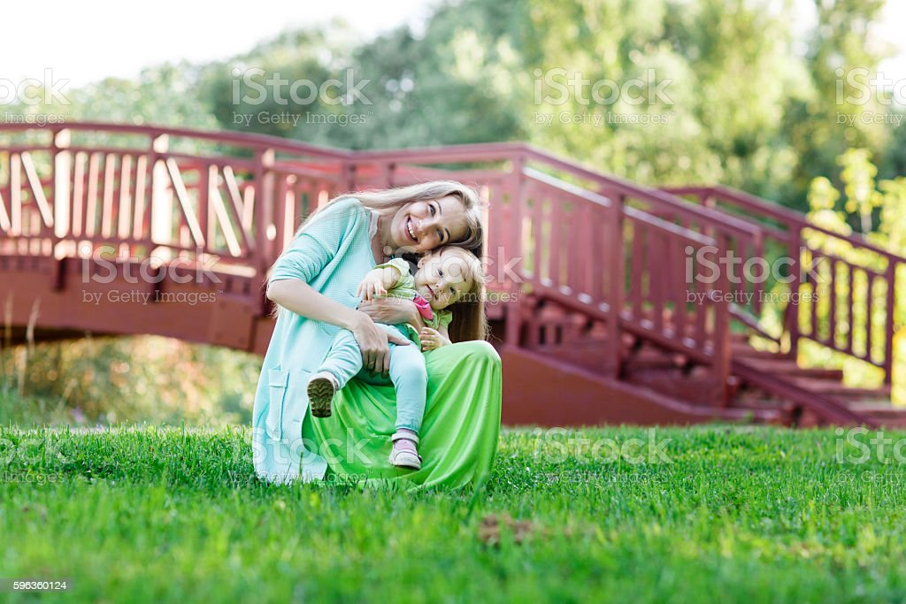mom gently hugs small daughter in park royalty-free stock photo
