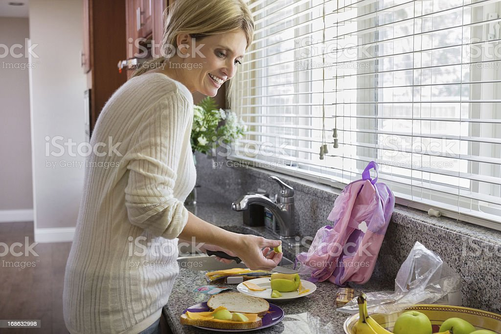 Mom getting school lunch ready royalty-free stock photo
