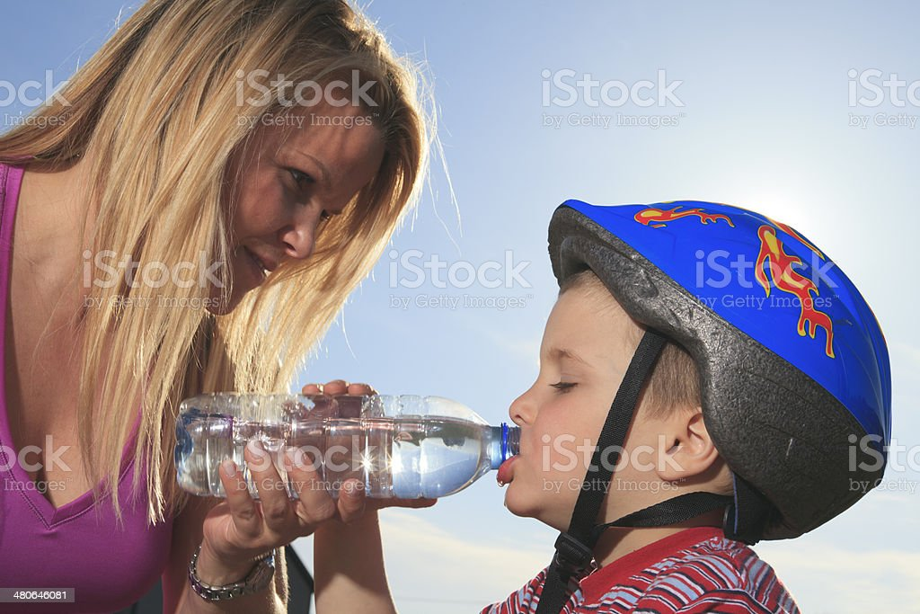 Mom Give Water Child stock photo