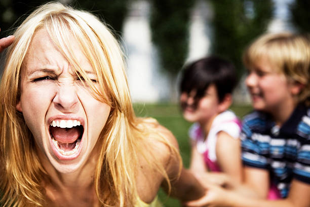 A mom going crazy while playing with her children stock photo