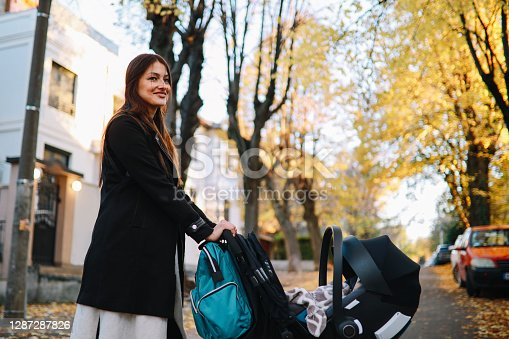 istock Mom going out for a walk with her baby boy 1287287826