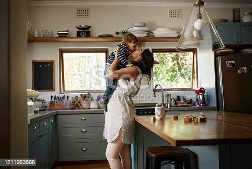 Shot of a young woman spending quality time with her adorable child at home