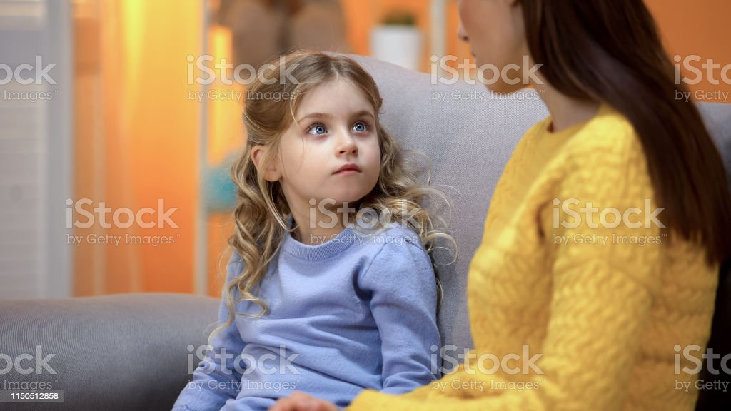Mom having serious conversation with girl, explaining kid mistakes in behavior - Royalty-free Acting - Performance Stock Photo