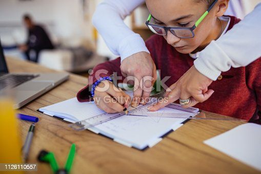 680535874 istock photo Mom helping son with math 1126110557