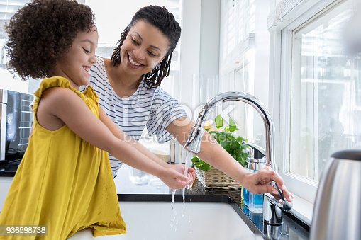 istock Mom helps young daughter wash hands 936598738