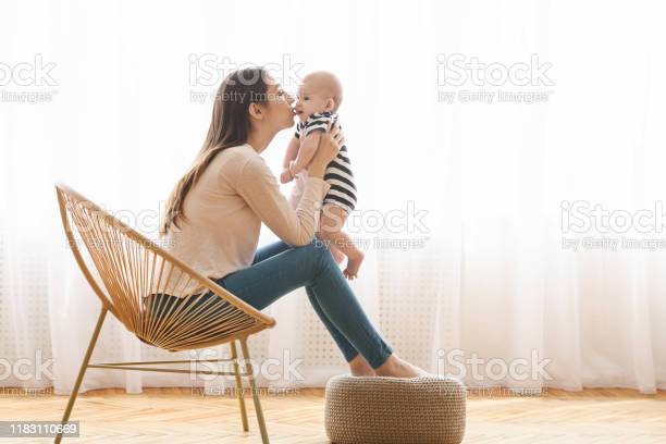 Mom holding newborn baby in hands and kissing his cheek picture id1183110669?b=1&k=6&m=1183110669&s=612x612&h=gk3yp0zth5hj6sjxmemq8dkjgvofbxezdezgld2qxt8=