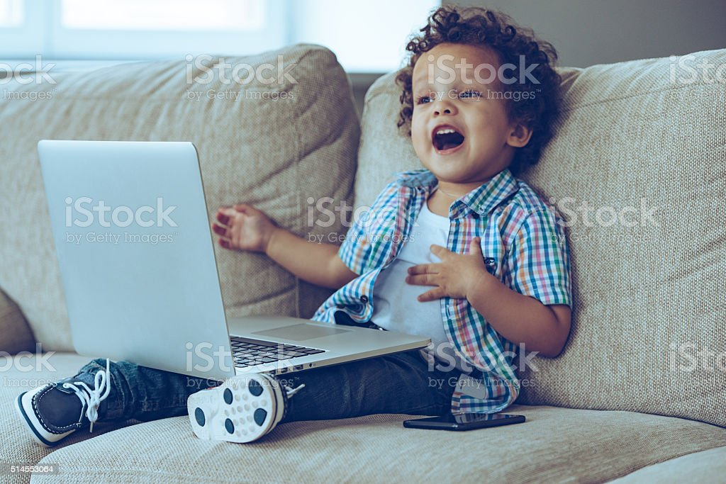 Mom how does this thing turns on? stock photo