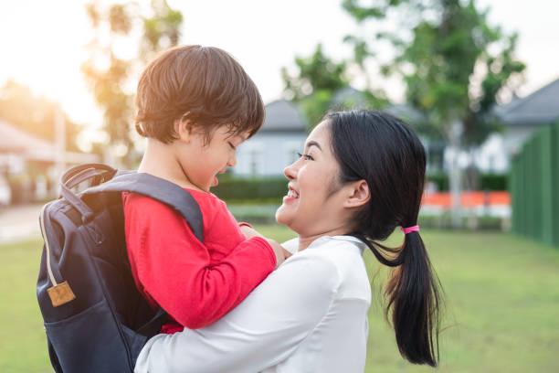 Mom hug and carry her son preparing to send her children back to in picture id965590118?b=1&k=6&m=965590118&s=612x612&w=0&h=9kqqmnjlxbog4rb52o1oka3m twt9r9rpjn7t okine=