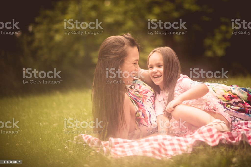 Mom is happy when her child is happy too. Mother and daughter in...