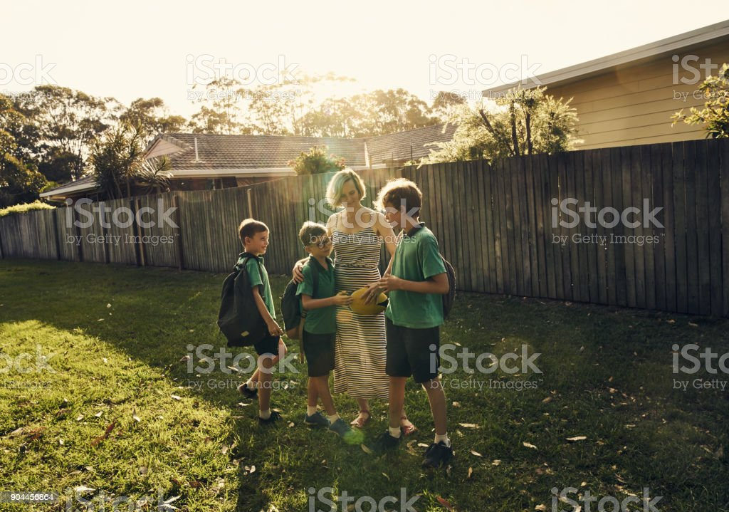 Mom is here to see that everyone plays fair stock photo