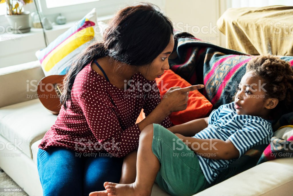Mom is pointing and blaming her son stock photo