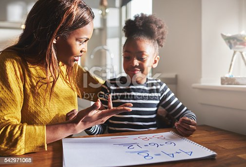 istock Mom learning daughter to calculate 542971068