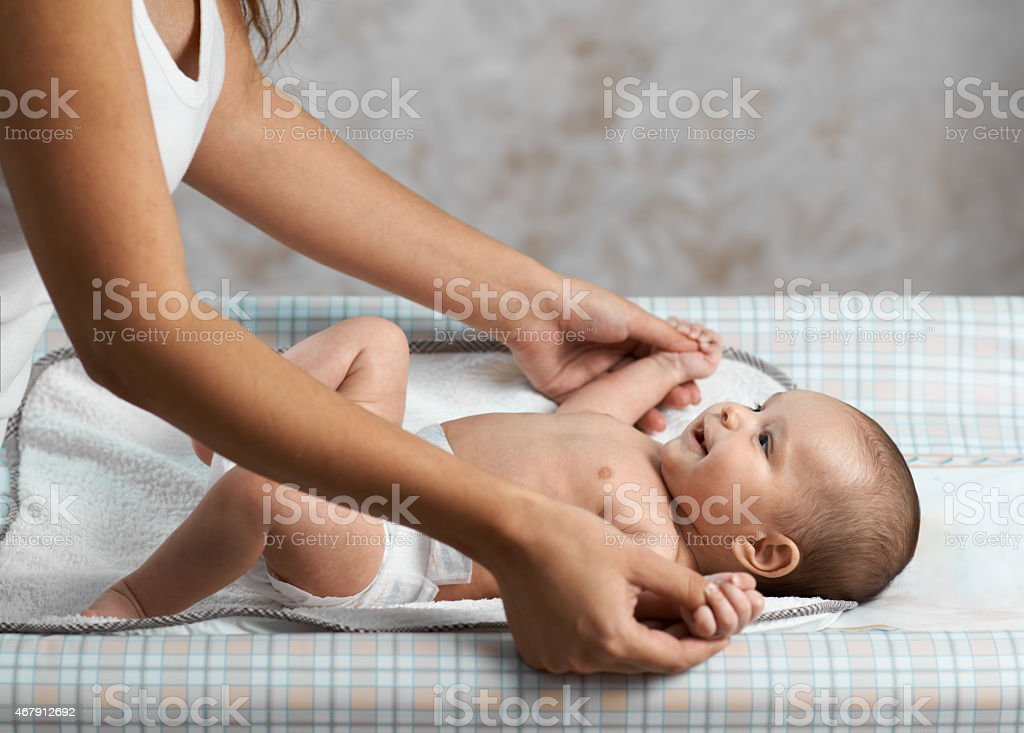 Mom makes exercise a child stock photo
