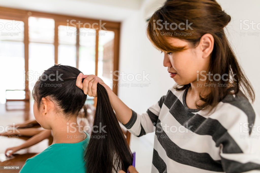 Mom Makes Her Daughter A Hairstyle Stock Photo More Pictures Of