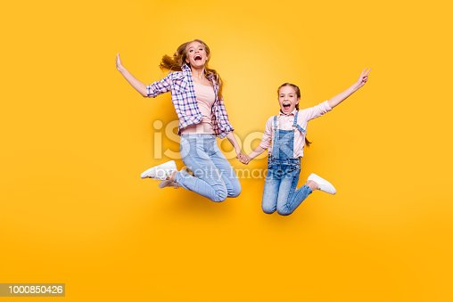 istock Mom mum mommy maternity two people best friendship upbringing rejoicing concept. Full length size portrait of cheerful joyful stylish modern relatives jumping up in air isolated on bright background 1000850426