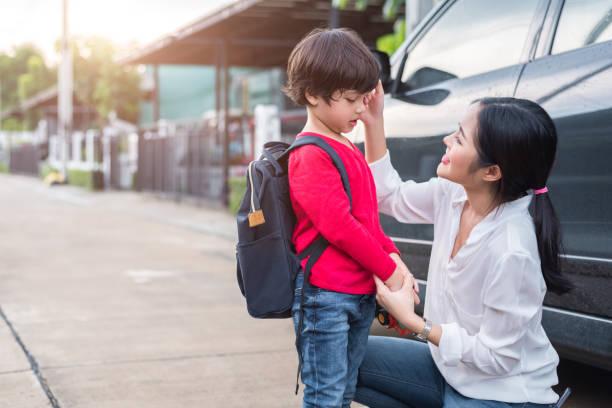 Mom preparing to send her children back to school at car in morning picture id954952682?b=1&k=6&m=954952682&s=612x612&w=0&h=cs7ercyg5onu1dscn1gbhtbaozj45rzyjdr ljfilgc=