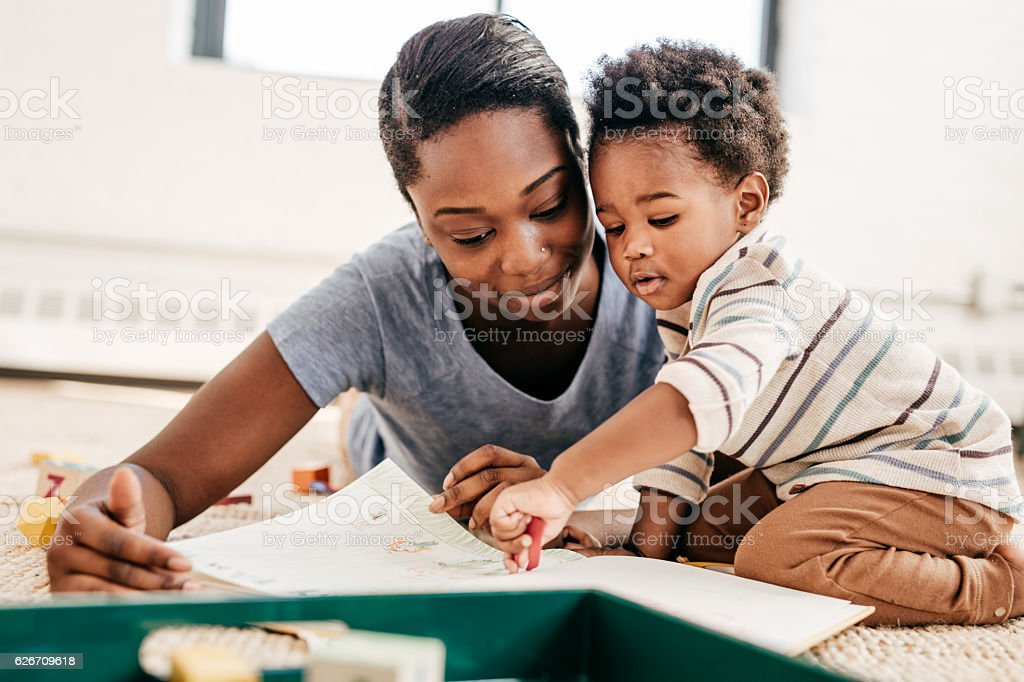 Mom reading for toddler stock photo