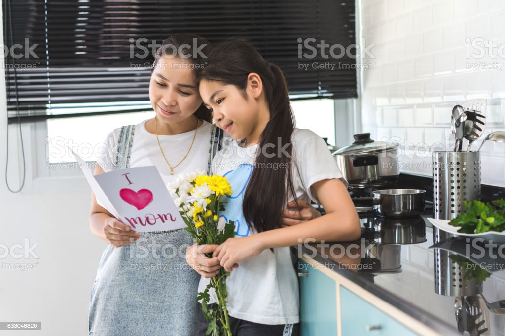 Mom Reading Leather Postcard And Children Girl Holding Flower ...