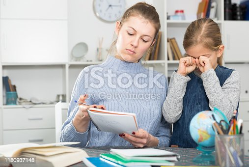 Mom scolds little daughter for poor grades in school